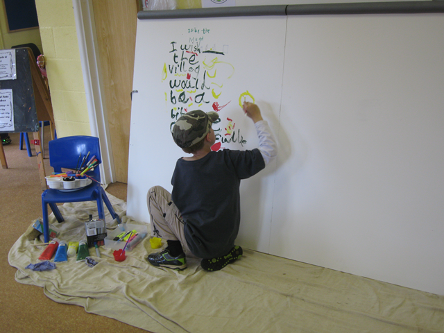 Child drawing on a wall