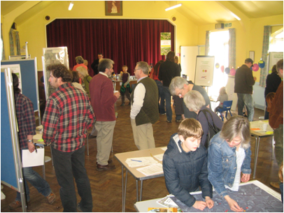 People milling around in a hall