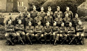 A group of people in uniform posing for a photo