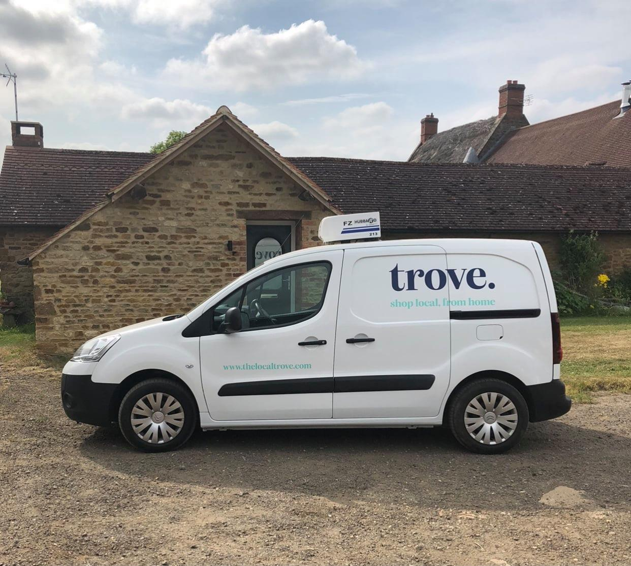 A van parked in front of a house